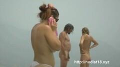 Nude beach voyeur shot of naked brunettes sunbathing Thumb