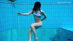 Frisky Alla Birtakik Undresses Nude in The Swimming Pool Thumb