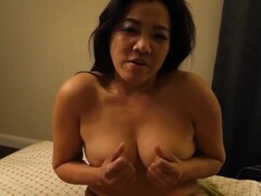 Asian milf playing with her tits Thumb