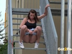 Fit Brunette Pees Down The Stairs Thumb