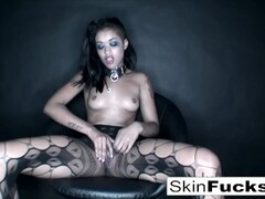 Skin Playing with her tight pussy wearing sexy fishnets Thumb
