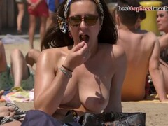 A nice woman goes topless on the beach Thumb