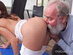 Juicy brunette works out in front of a curious old man Thumb