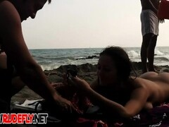 Nude beach filled with hot babes and an unsuspicious voyeur Thumb