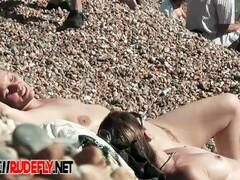 a big ass is starring in this playful nudist beach voyeur video Thumb