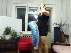 A mature aunt puffs up a circle and jumps on it. Inflatable fetish Thumb