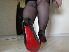 Appetizing fat legs in black nylon and in classic shoes with heels. Thumb