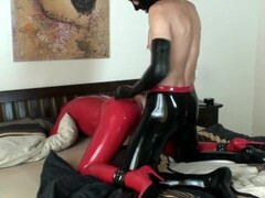 Fuck The Girl In Red Full Rubber Latex Catsuit + Mask + Gloves + High Heels Thumb